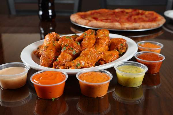 Wings with various dipping sauces