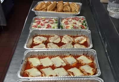 catering trays of lasagna and salad