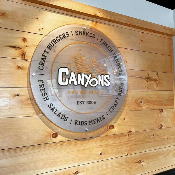 canyons sign on wooden wall