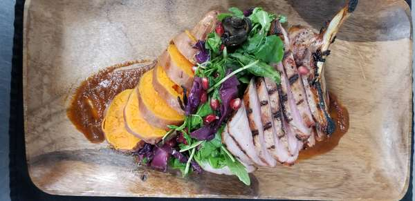 grilled chicken entree on cutting board
