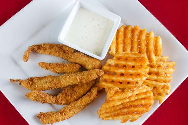 Homemade chicken strips with seasoned potatoes