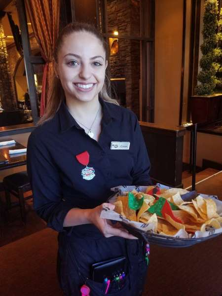 server with tray of food