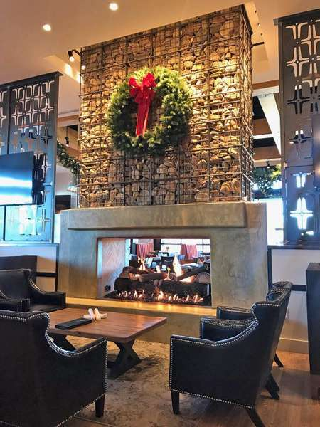 stone fireplace with Christmas wreath