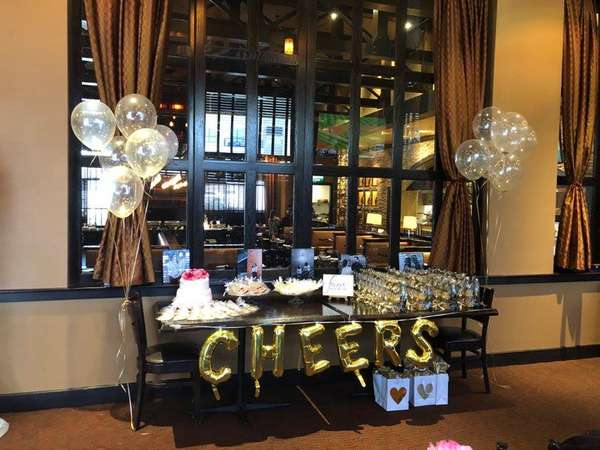 table decorated with balloons and cake