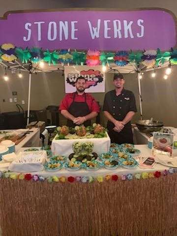staff beside catering table