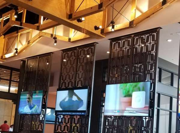 wall with iron work and tvs