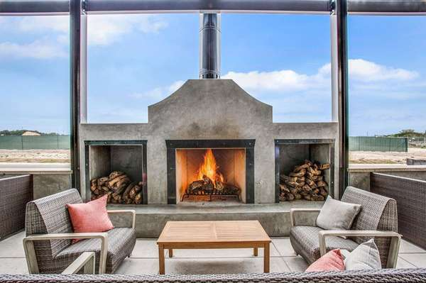 outdoor patio area with fireplace