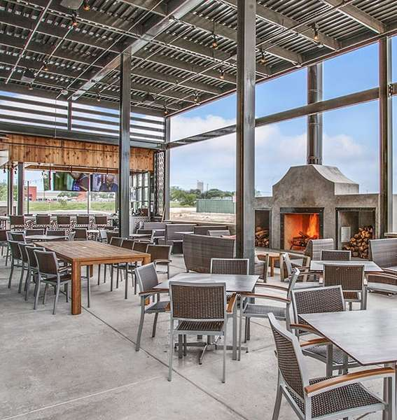 outdoor dining area with firepalce