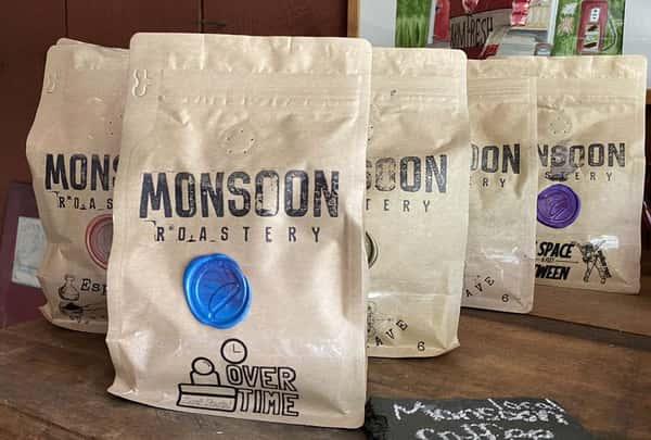 Bags of Monsoon Roastery Coffee Beans