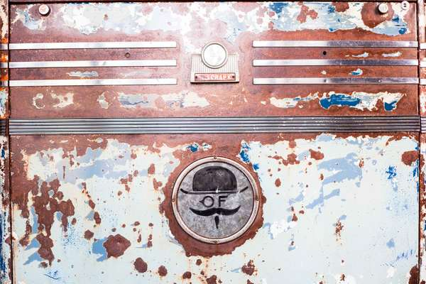 old rusted logo