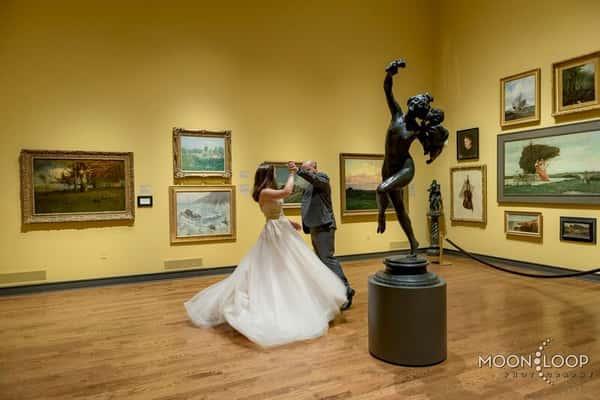 bride and groom dancing in museum
