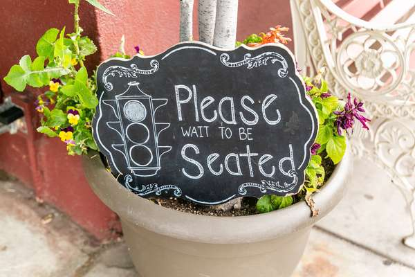 sign - please wait to be seated