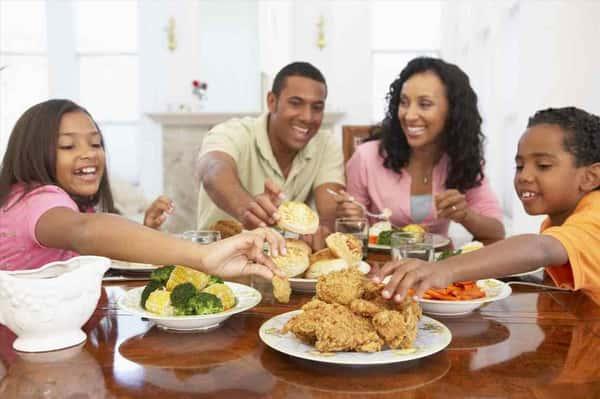 Black family enjoying a meal