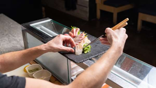 staff member preparing sashimi