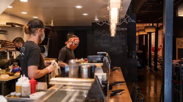 staff members at sushi bar
