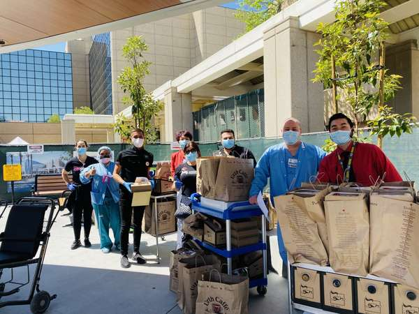 Nurses outside of Kaiser Permanente Woodland Hills Medical Center with carts and bags of Urth food