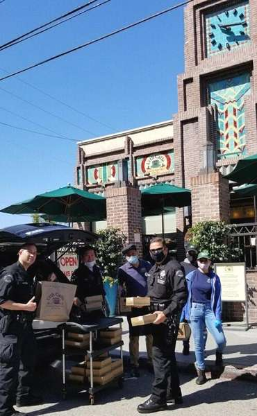 Loading Urth Caffé Lunch Boxes into Police van in front of Urth Downtown