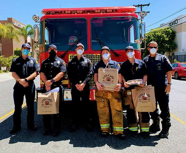 Lawndale Firetruck front with 6 firemen Urth Caffé brown paper food bags.