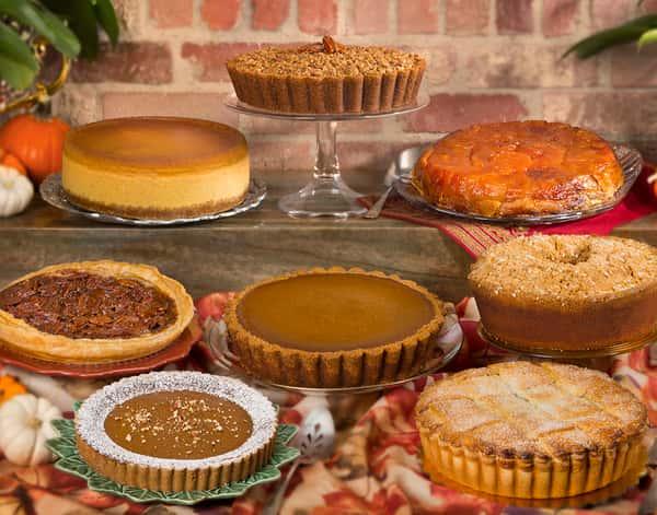 "pie display with Pumpkin cheesecake, Sweet potato pie, Apple Tarte Tatin, Pumpkin, Old-fashioned pecan pie, Apple, Vegan Gluten-Free Pumpkin 8"" pie and Pumpkin fondant pound cake"