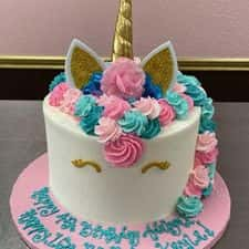 """2 Layer 8"""" Inch round cake : Buttercream frosting and Unicorn Decor."""