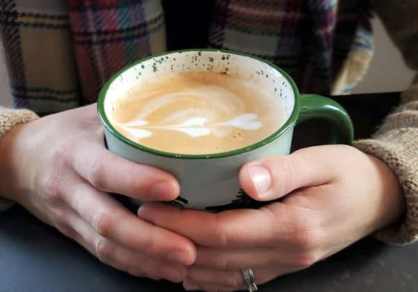 hands around coffee