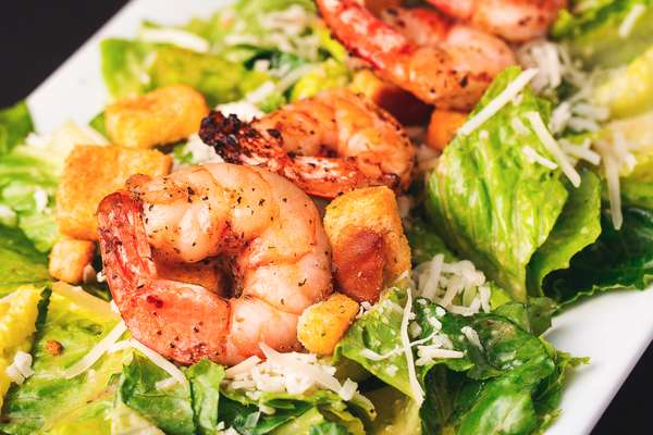 Caesar Salad topped with Grilled Shrimp