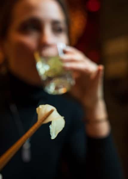 drinking sake with chopsticks