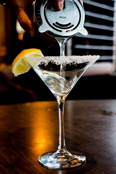 cocktail shaker pouring martini