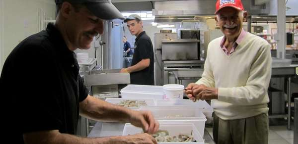 The original Seafood Sam (right), doing prep work with Jeff, co-owner of our Sandwich restaurant