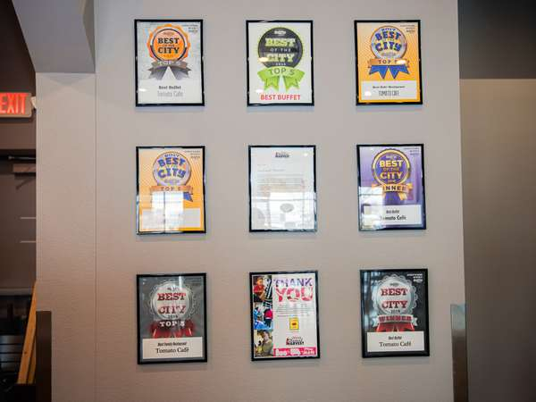 Wall with awards won by Tomato Cafe