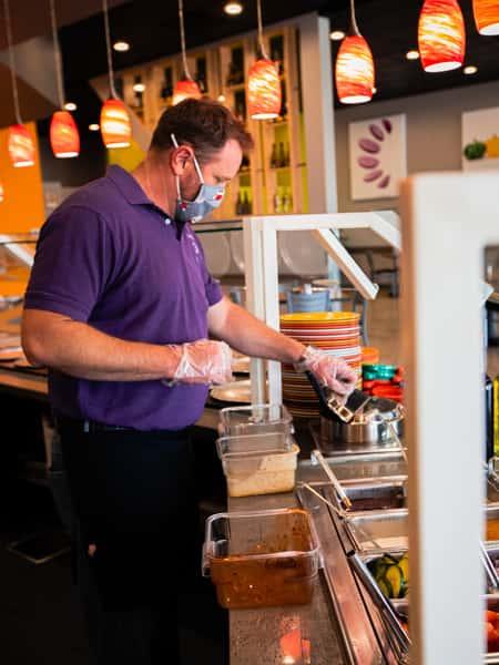Staff preparing food at the food bar