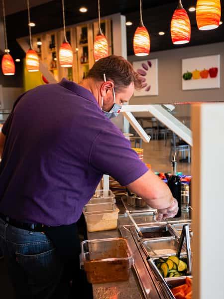 Staff prepping the food bar