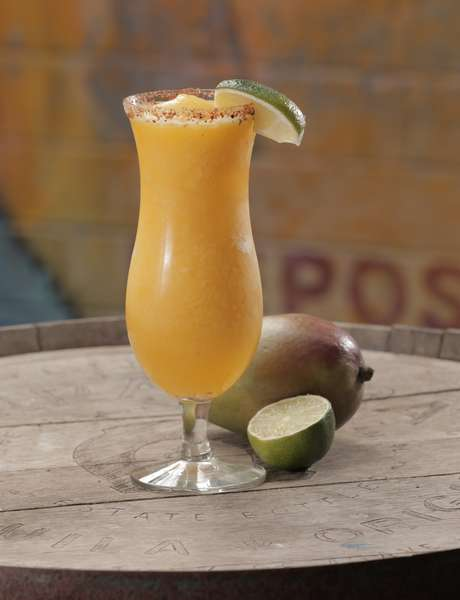 Frozen Mango Tango Margarita. Rimmed with Chile Lime Salt