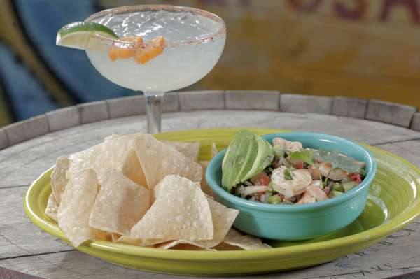shrimp ceviche topped with avocado and served with homemade chips. Served along side with a handcrafted habanero margarita.
