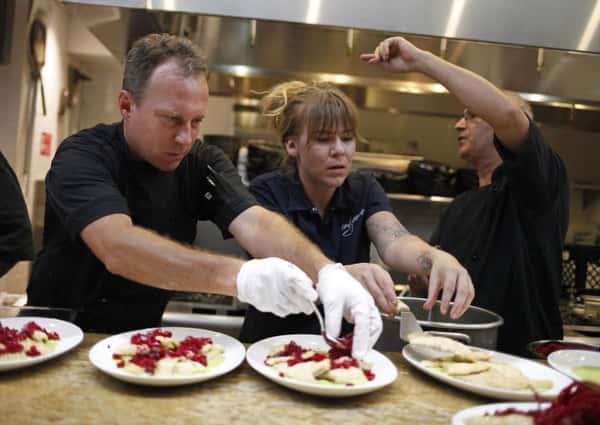 chefs arranging food