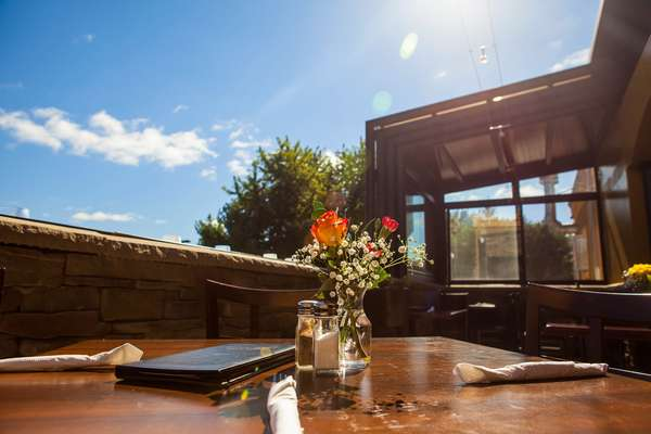 outside table setting with flowers and blue sky