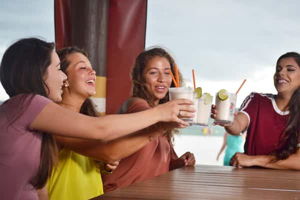Girls Cheering with Key Lime Pie Milkshakes