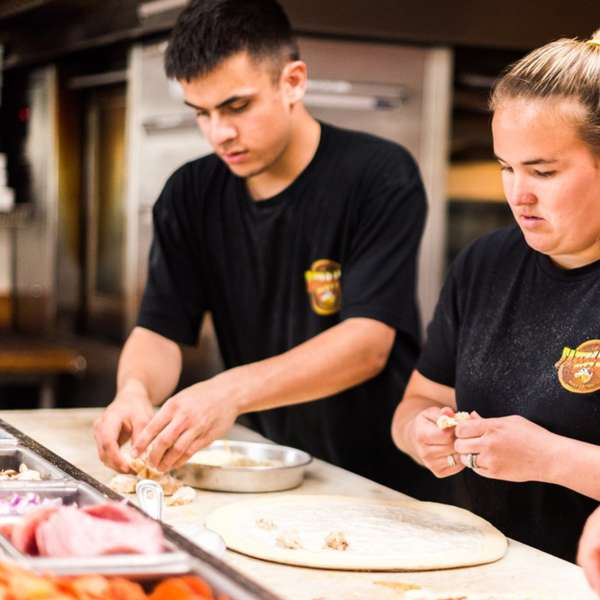 Fazerrati's Pizza Employees Making Pizza