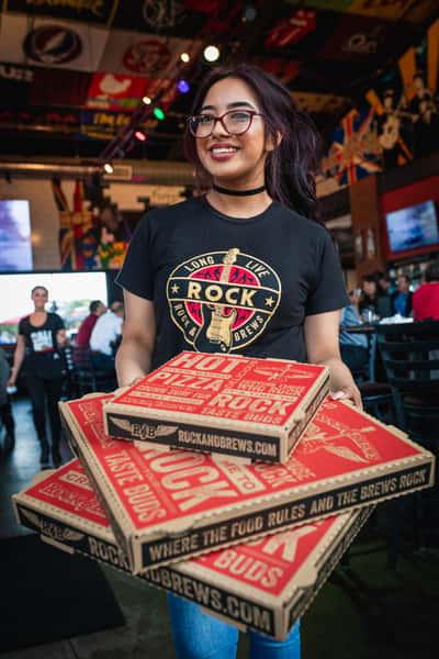 waitress holding pizza boxes