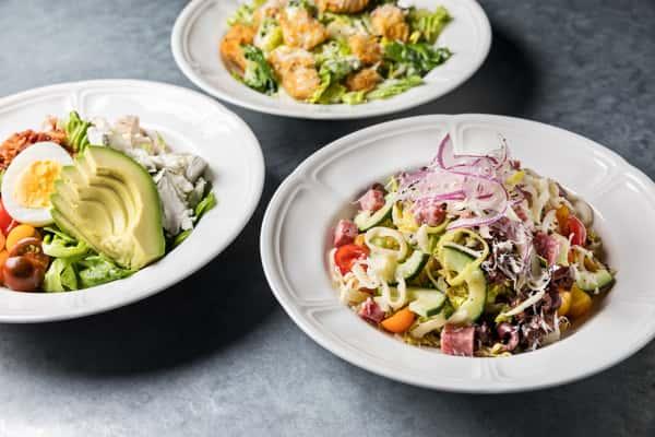 Little Gem Caesar Salad, California Cobb Salad, Chopped Antipasto Salad