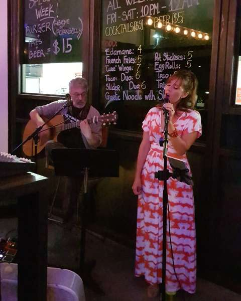 Live singer at the Cure Kitchen & Bar