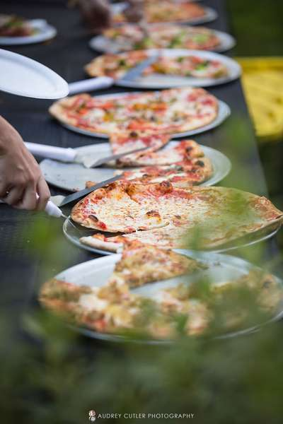 Row of pizzas at wedding