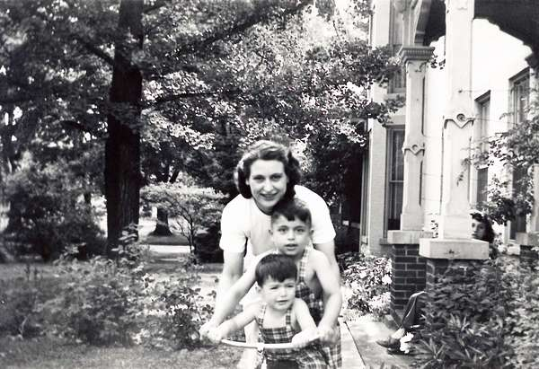 old black and white photo of Comella's family member a woman and two young boys