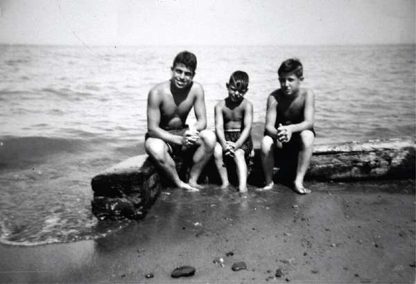 old black and white photo of Comella's family members on the beach