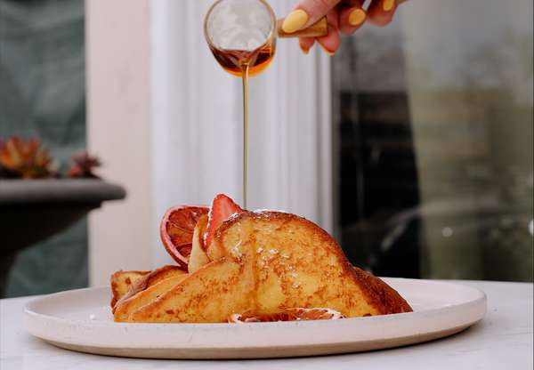 Organic brioche french toast with free range eggs and real maple syrup