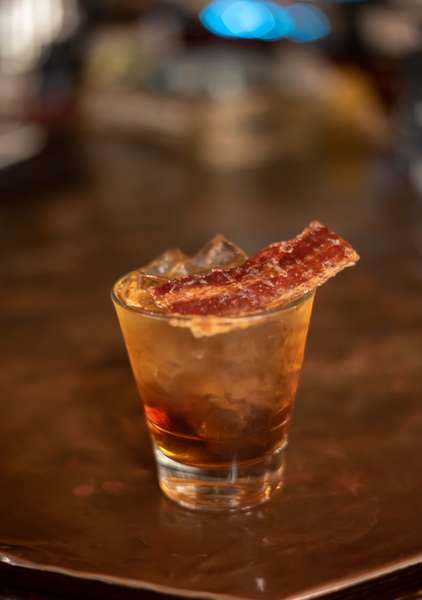 The Tusk - Bulleit Bourbon Whiskey, maple infused vermouth, candied bacon.