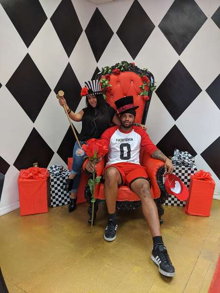 couple in red chair at a tea party at queen of hearts las vegas