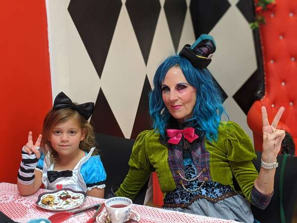 child and woman dressed up for high tea