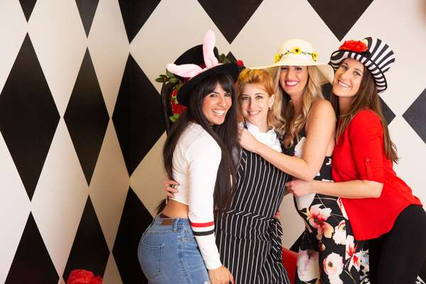 wommen and chef sweetser at a tea party at queen of hearts las vegas