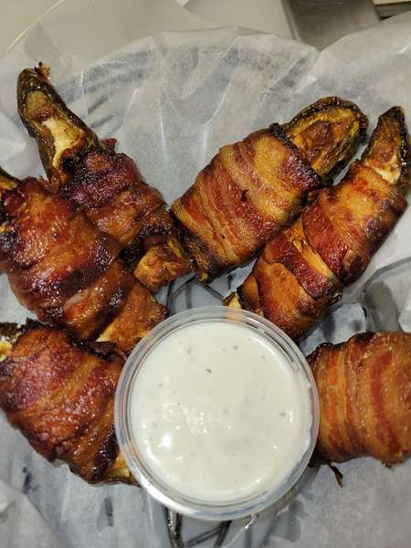 Smoked bacon wrapped Jalapeño poppers. Available during pro football games